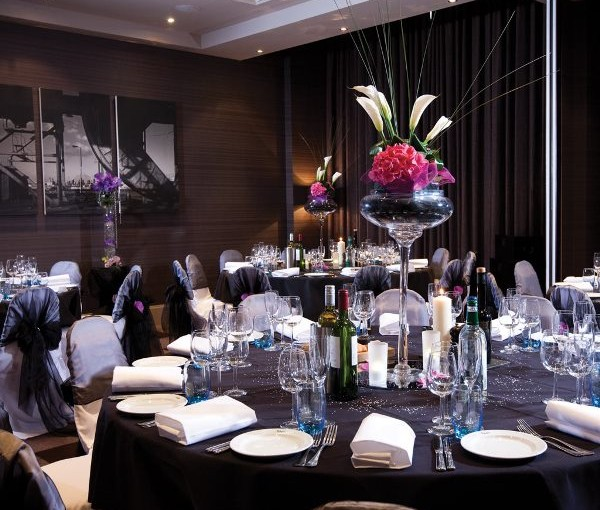Malmaison Liverpool Venue Hire L3, private dining on black covered rounds with flower centre pieces
