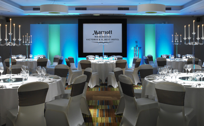 John Logie Baird Suite set up for an awards dinner with round tables and presentation screen Manchester Marriott Victoria Albert Hotel Christmas