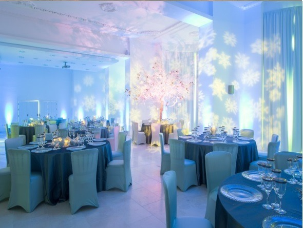 Royal Liver Building Christmas Party L3, seated dinner set up with chair covers and centre pieces