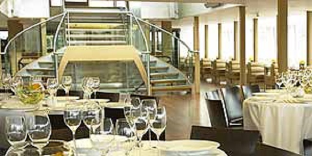 Silver Sturgeon Christmas Party WC2. imahes of dining space with staircase of boat. With contempary feel.