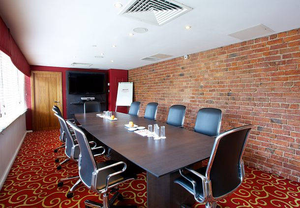 Irwell Room set up in boardroom style with natural daylight for a meeting Manchester Marriott Victoria Albert Hotel Venue Hire M3