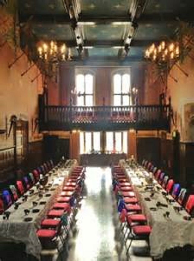 Redworth Hall Hotel Christmas Party DL5. Long tables set out for christmas seated dinner. with high ceiling and in a histroic building. Festive feel for christmas celebration.