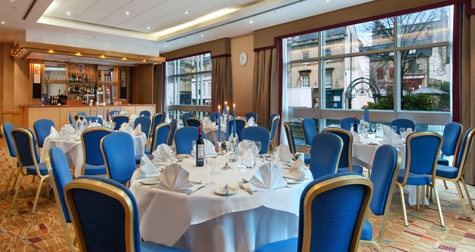 Hilton Bath Christmas Party BA1, private dining with blue chairs and table dressings