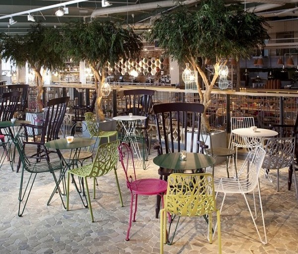 Folly Venue Hire London EC3. Inside of the venue with coloured chairs and round tables