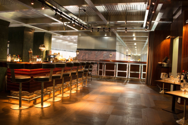 View of the private bar with high bar stools on the Mezzanine One Canada Square Venue Hire E14