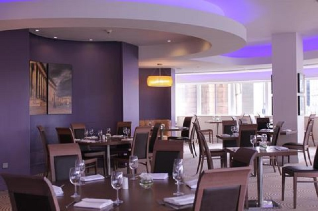 Atlantic Tower Hotel L3, spacious dining area with large windows to spectaular views.