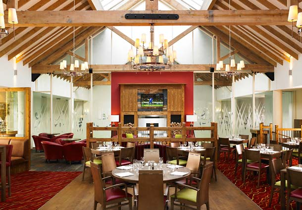 Dalmahoy Hotel and Country Club Summer Party EH27, seated area, large open doors into outside space, natural daylight