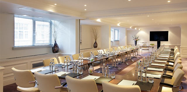 Marylebone Hotel Venue Hire London W1. Venues conference space. Tables set out cabrieot style with screen for meeting.