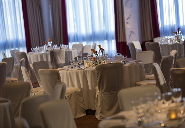 Medici Ballroom set up for a wedding with round tables dressed in white linen at the Renaissance Manchester Venue Hire M3