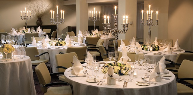 Marylebone Hotel Venue Hire London W1. Venues private dining area with tables set out for guests.