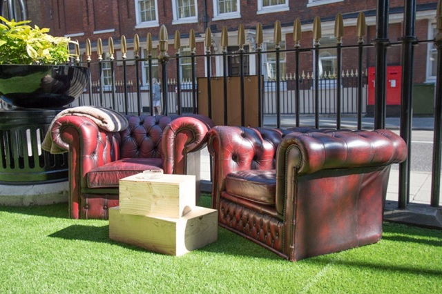 Sipsmith Terrace with parasols, astro turf and chester field sofas Jugged Hare Summer Party EC1