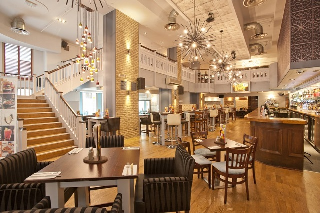 Slug and Lettuce Wood Street Venue Hire EC2. Venues ground floor of chairs and tables set out.