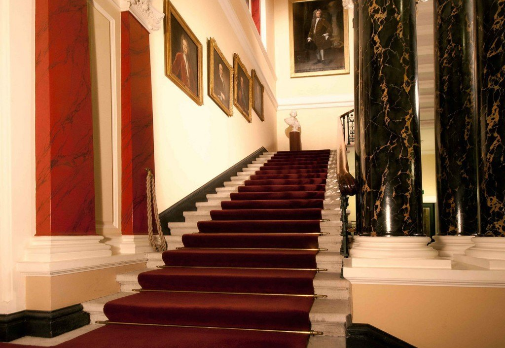 Society of Antiquaries Christmas Party W1, white marble stair case with red carpet