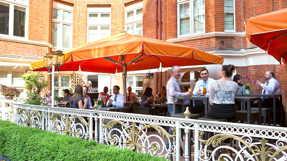 St Ermins Hotel Summer Party SW1, terrace with orange umbrellas