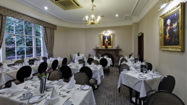 English Garden Restaurant set up for a Christmas dinner with natural daylight Grange White Hall Hotel Christmas Party WC1