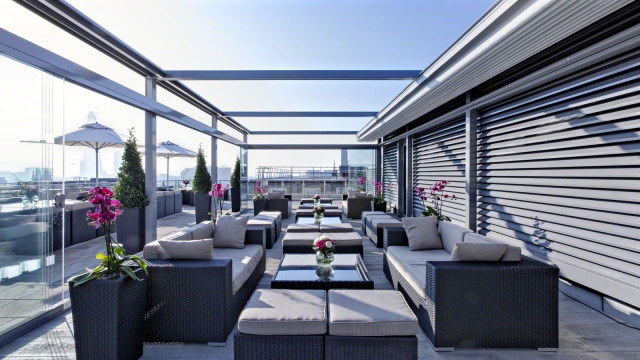 View of the sky bar with retractable roof and sofas Grange St. Pauls Hotel Summer Party EC4