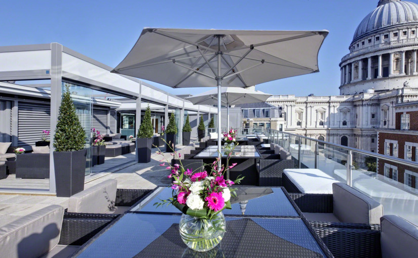 Sky Bar with sofas and parasol with views of London Grange St. Pauls Hotel Summer Party EC4