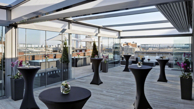 Sky bar set up for a drinks reception with poseur tables Grange St. Pauls Hotel Summer Party EC4