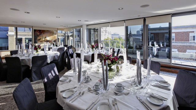 Royal Suite with round tables set up for a lunch with natural daylight Grange St. Pauls Hotel Venue Hire EC4