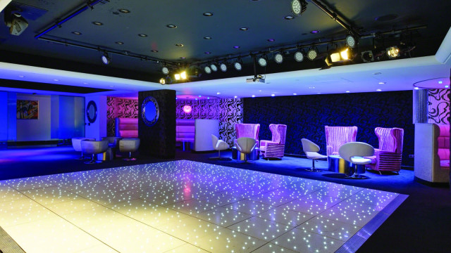 Club Ten with fairy light dance floor and purple lighting Grange St. Pauls Hotel Venue Hire EC4