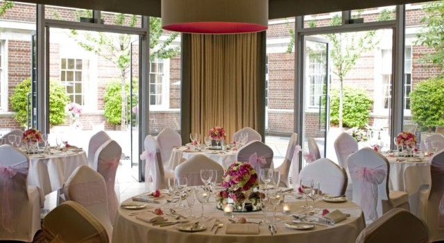 Devonport House Venue Hire SE10, round tables, seated dinner, flower centre pieces, natural daylight