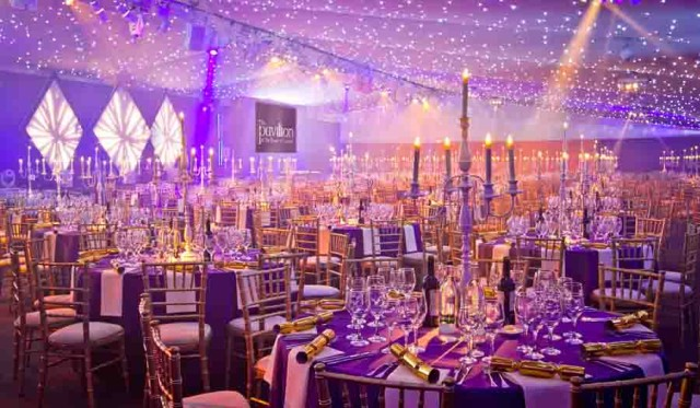 Pavilion at the Tower of London Shared Christmas Party EC3, seated dinner set up ,candelabras, ceiling lighting, fairy lights, Christmas novelties