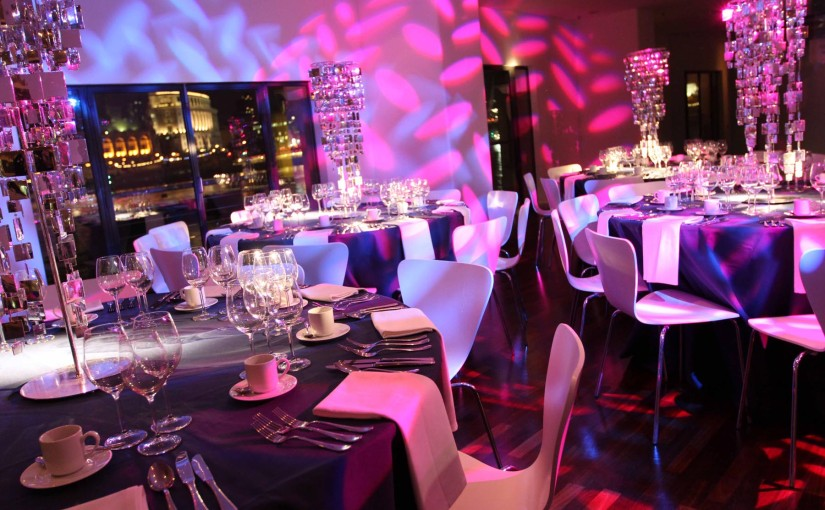 OXO2 Christmas Party SE1, festive set up, stunning centre pieces, round tables, stunning views
