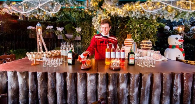 bartender in Christmas attire with Christmas cocktails at Montague's Ultimate Ski Lodge Christmas Party WC1