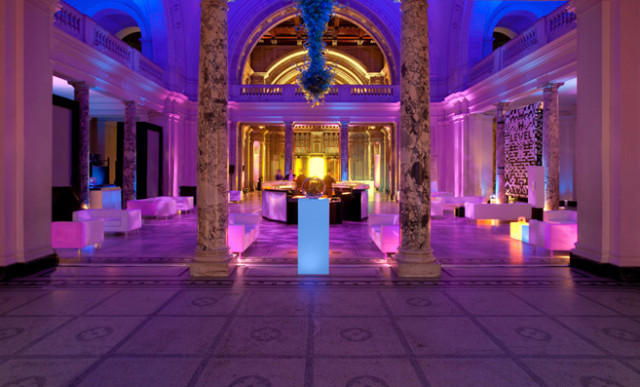 Main Hall set for a drinks reception with poseur tables lit up and stunning entrance Banqueting House Christmas Party SW1