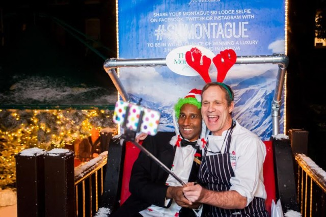 Montague's Ultimate Ski Lodge Christmas Party WC1- Christmas Photobooth with Snow Sleigh background with guests using a selfie stick
