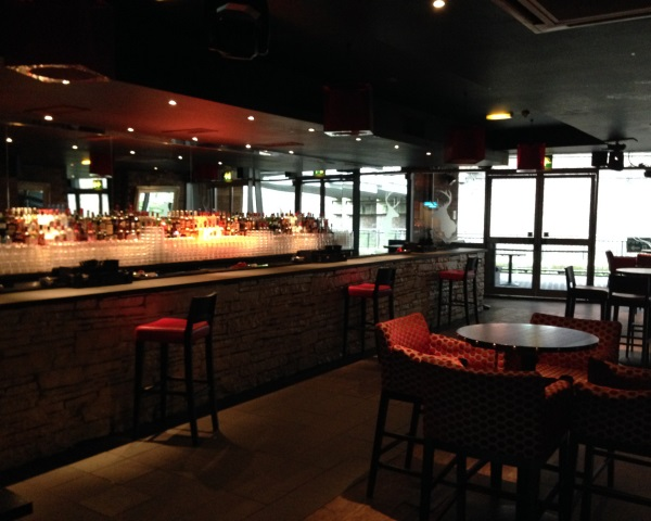 View of the main bar with high stools ARK Manchester Venue Hire M1