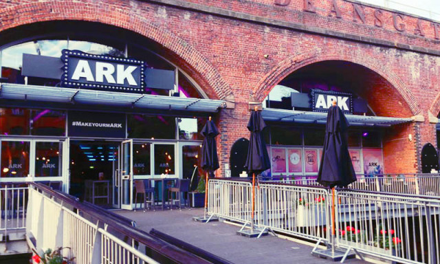 View of the Canal Terrace entrance with enlarges signage and parasols ARK Manchester Venue Hire M1