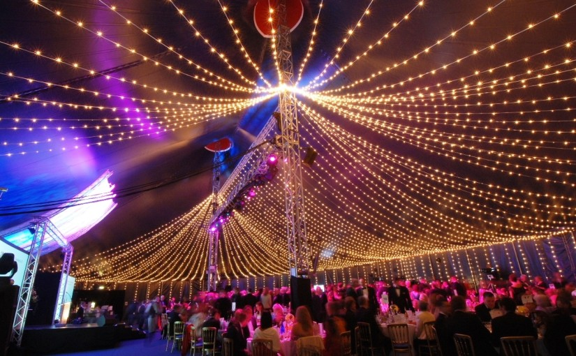 Bloomsbury Big Top Shared Christmas Party WC1, ceiling draping, large round tables
