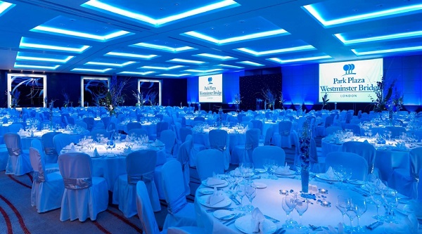 Park Plaza Westminster Bridge Christmas Party SE1. festive lighting in their ballroom with banqueting tables set out.