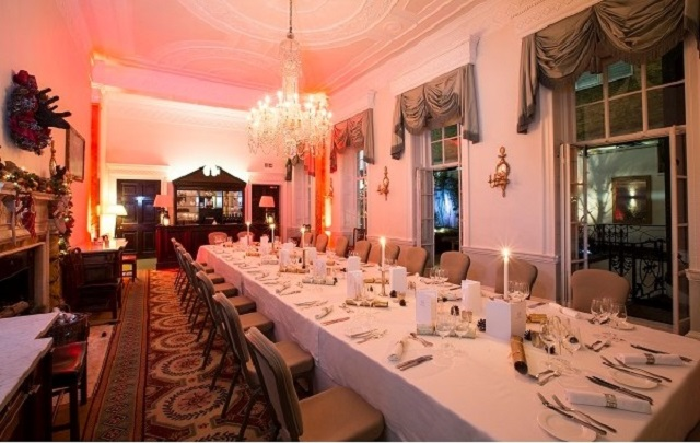 Chandos House Christmas Party W1 Long table set out for dining,