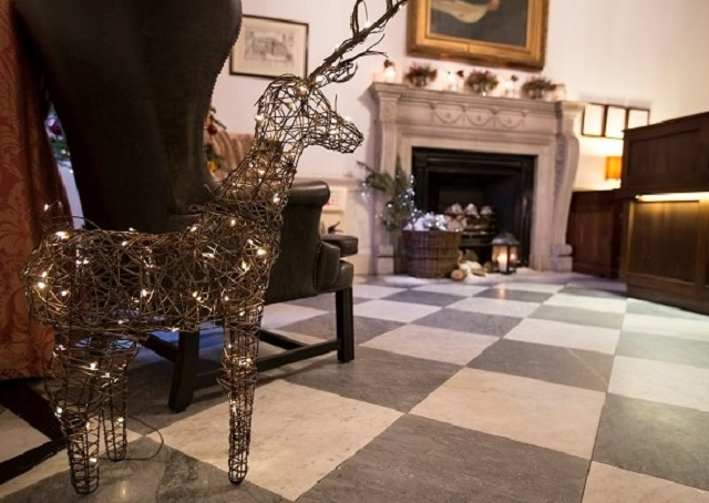 Chandos House Christmas Party W1. Seating area with Christmas decor and beautiful centre fireplace.