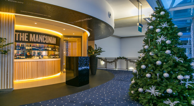 Foyer decorated with a Christmas tree at Manchester City Football Club Shared Christmas Party M11