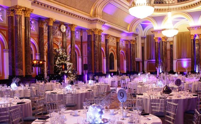 Gibson Hall Christmas Party EC2, stunning high ceilings, large pillars, round tables with festive decorations