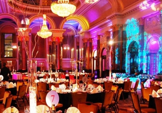 Gibson Hall Christmas Party EC2, large chandeliers, table centre pieces to compliment the round tables and table cloths