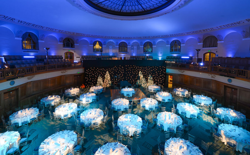 Church House Christmas Party Venue SW1, balcony views, round tables, seated dinner, festive decorations