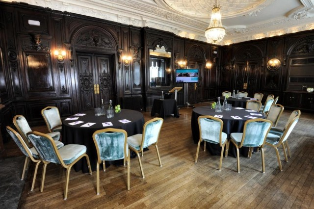Dartmouth House Venue Hire W1, Churchill suite, cabaret style conference set up, chandeliers, water and refreshments