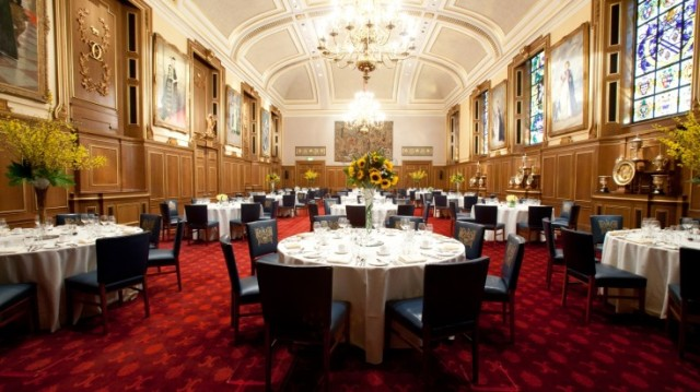 Livery Hall round tables dressed in white linen for a dinner at Clothworkers Hall Venue Hire EC3