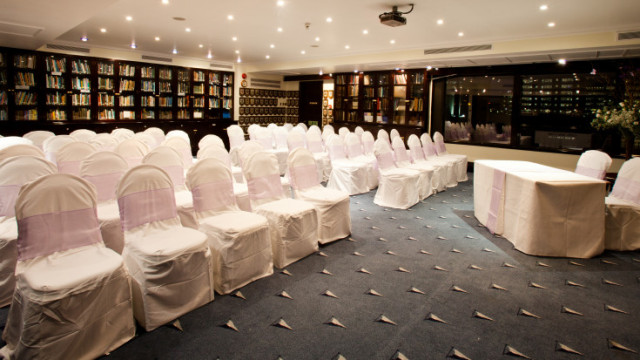 View of the Club Library in theatre style set out for a wedding Little Ship Club Venue Hire EC4