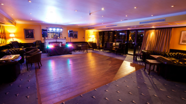 Club Room set up for a disco with DJ booth and lights Little Ship Club Venue Hire EC4