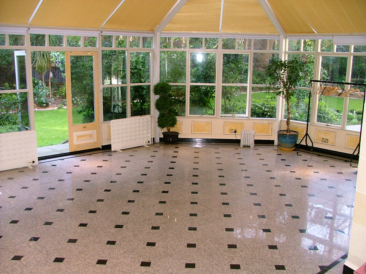 Large open space surrounded with glass white and black tiled floor over looking the garden Conservatory, Grange White Hall Venue Hire WC1