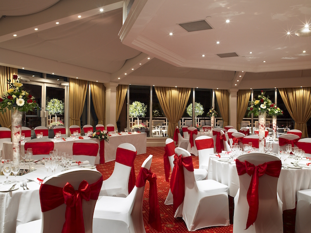Bristol Marriott Hotel City Centre Christmas Party BS1. Marriott set out for Christmas dining with round tables and chairs and red bows