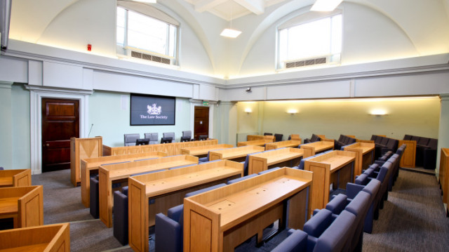 Council Chamber with pews in classroom teaching layout with screen at the front Law Society Venue Hire WC2