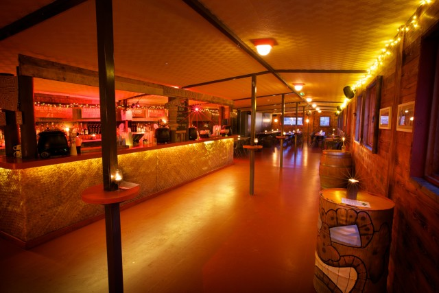 Alpine Lodge with large bar area and informal seating with cosy lighting Dinerama Christmas Party EC2