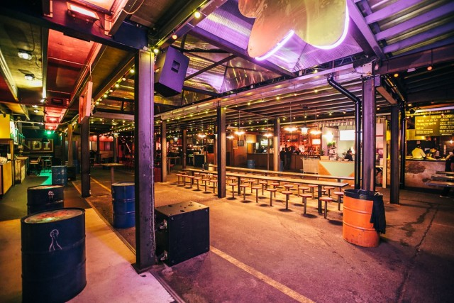 Ground Floor view with informal bench seating and large steel beams and oil drums Dinerama Venue Hire EC2