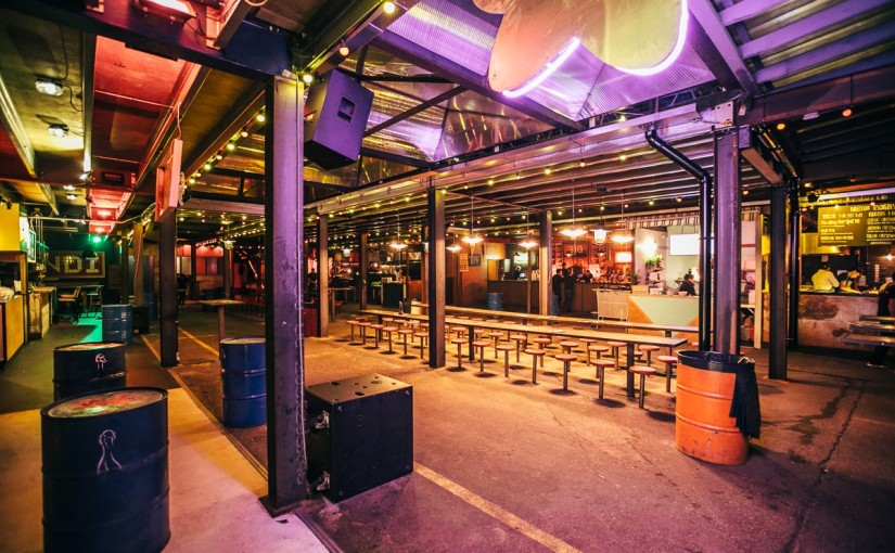 Ground Floor view with informal bench seating and large steel beams and oil drums Dinerama Christmas Party EC2